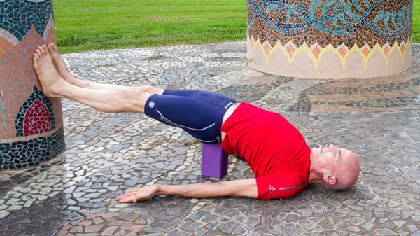Bridge pose with a block under sacrum